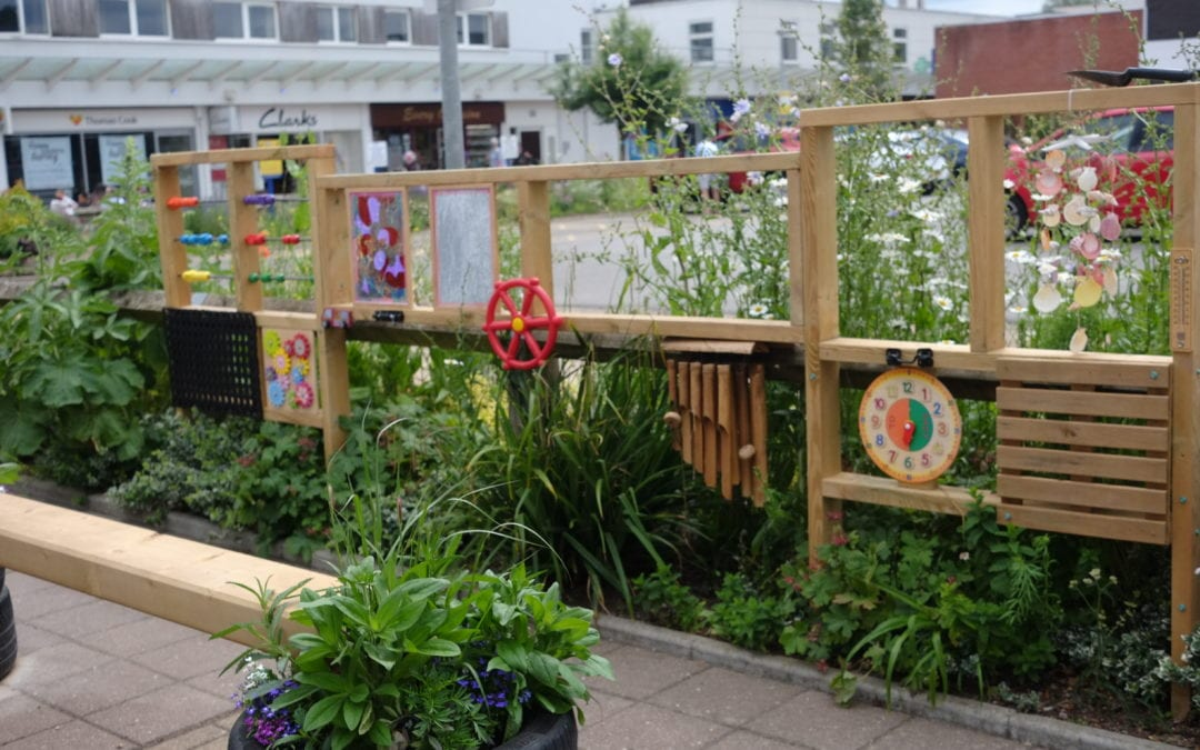 Talisman transformed with flowers, art and benches